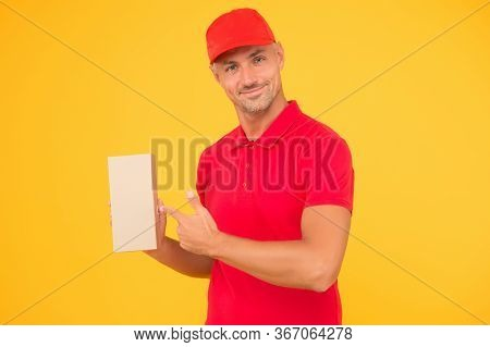 Your Parcel Our Passion. Courier Guy Point Finger At Parcel Box. Delivery Man In Red Uniform Yellow