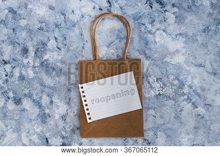 Reopening Businesses After The Covid-19 Virus Pandemic, Retail Shopping Bag With Reopening Memo