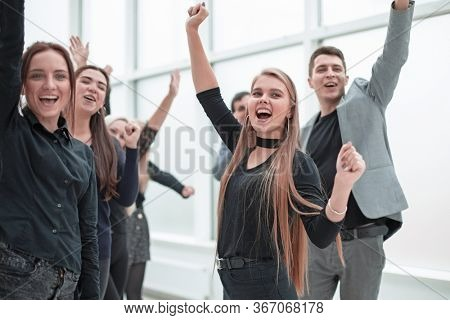 young employees applauding together standing in the office .