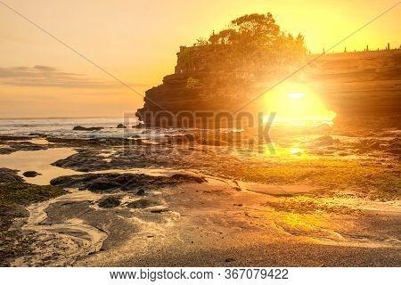 Beautiful Sunset View Look Through Arch Rock Below Pura Batu Bolong An Iconic Hinduism Sea Temple In