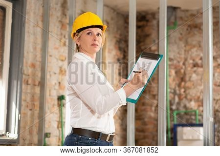 Woman at work on construction site