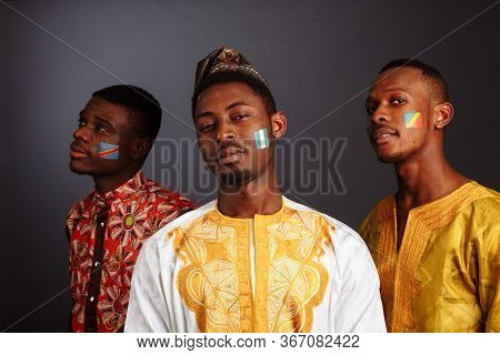 Concept Of Friendship Between African Countries: 3 American Men In National Clothes From Different C