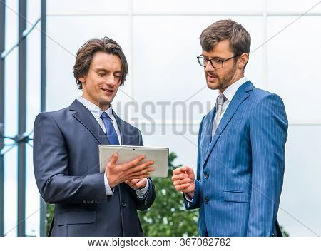 Confident Businesspersons In Formal Wear Having Conversation About Banking And Financial Markets In