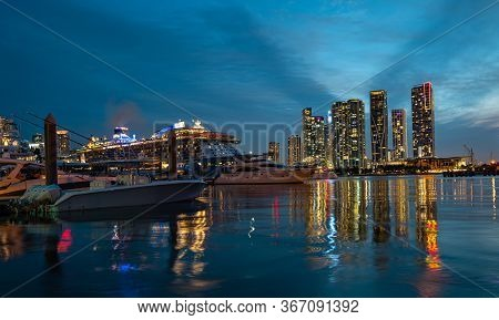 Cruise Ship And Downtown Skyscrapers In Miami. Miami Florida, Skyline Of Downtown Night Colorful Sky