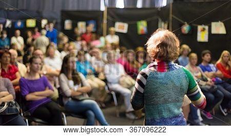 Female Academic Professor Lecturing At Scientific Public Event.