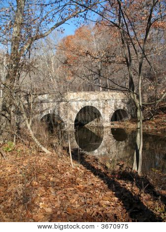 Fieldstone Bridge Over Winter Stream