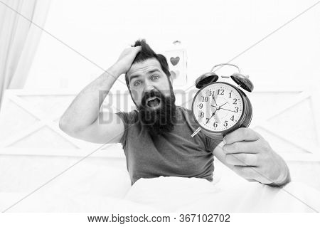 Stress Concept. Man Awake Unhappy With Alarm Clock Ringing. Insomnia Drives Me Crazy. Wakes Up In Mo