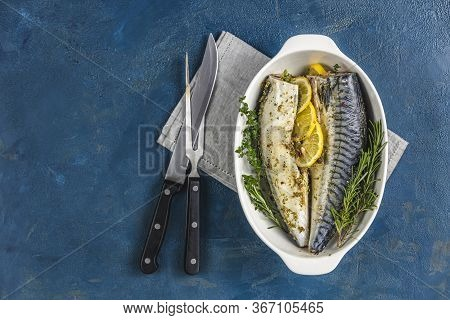 Mackerels Served On White Dish With Lemon, Thyme, Rosemary And Spices. Raw Marinated Fishes With Cut