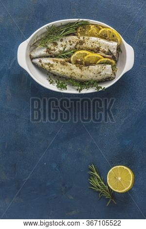 Mackerels Served On White Dish With Lemon, Thyme, Rosemary And Spices. Raw Marinated Fishes On Class