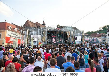 BRASOV, ROMANIA - JULY 29 :  People at Music Festival Ursus Evolution. Open-air Concert   at Piata Sfatului on  July 29. 2012. Brasov, Romania.
