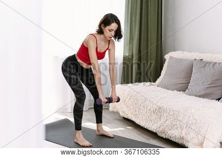 Lovely Woman Goes In For Sports With Dumbbells At Home. Determined Woman Losing Weight At Home And E
