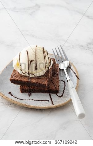 Chocolate Brownie With Ice Cream. Copy Space.