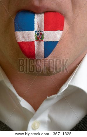 Man Tongue Painted In Dominica Flag Symbolizing To Knowledge To Speak Foreign Language