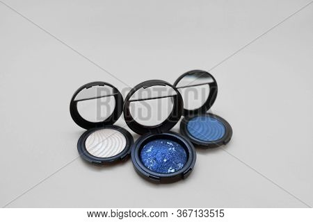 Three Types Of Eye Shadow On A Light Background, Shiny And Shining In Black Packaging. Shades Of Sil