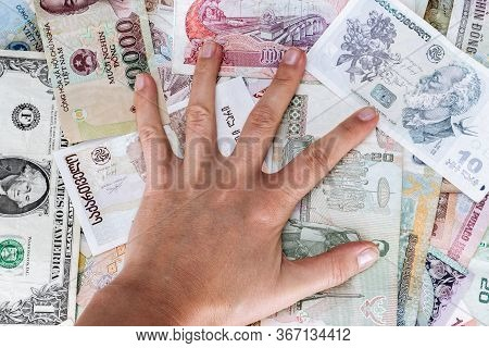 Greedy Hand Man Presses The Money From Different Countries