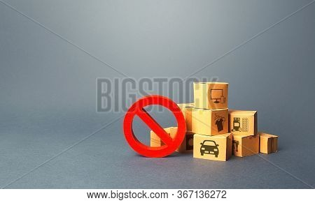 Boxes And Red Prohibition Sign No. Overproduction Of Goods, Lack Of Demand. Sanctions And Embargo. S