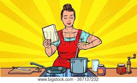 A Woman Cooks In The Kitchen. Pop Art Retro Vector Illustration 50s 60s Style