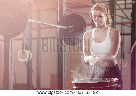 Beautiful Blonde Girl Preparing To Weightlifting At Fitness Center