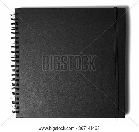 Black Notebook Isolated On A White Background. Closed Sketchbook With Black Paper And Hardcover.
