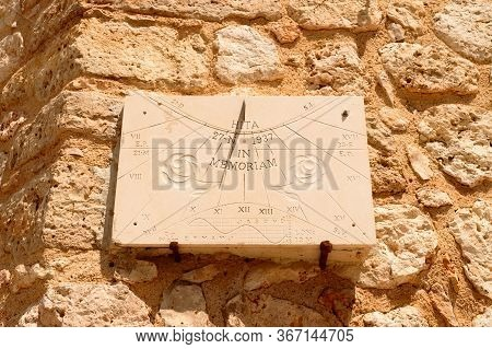 Precious Sundial Sculpted On The Wall In Memory Of The Archpriest Of Hita. July 23, 2019. Hita Guada