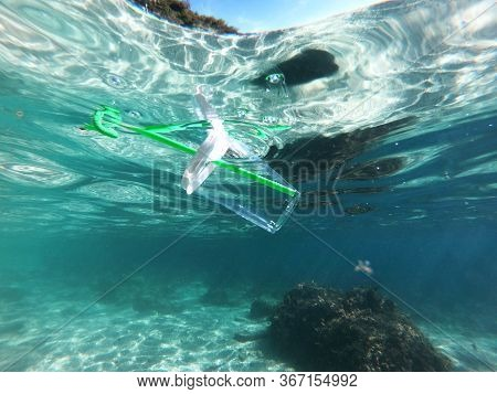 Plastic Cup Is On The Surface Of The Sea