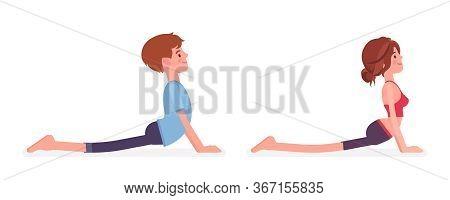 Young Yogi Man, Woman In Sports Wear Practicing Yoga, Partners Doing Cobra Pose, Bhujangasana Exerci