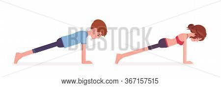 Young Yogi Man And Woman In Sports Wear Practicing Yoga, Partners Doing Plank Pose, Push Ups Or Pres