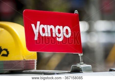 Tel Aviv, Israel. May 19, 2020. White Israeli Taxi Cab With A Yango Logo On A Roof. Yango Is An Isra
