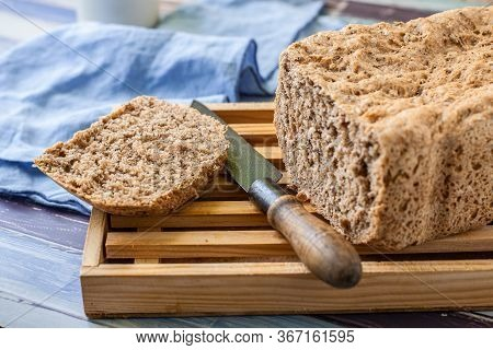 Homemade Rustic Bread On Wooden Table Whit Old Knife