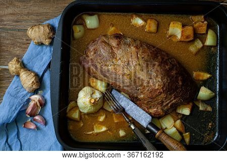 Cooking A Piece Of Pork To Make Pulled Pork