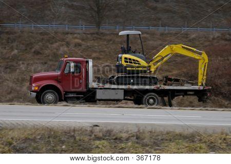 Truck Hauling Backhoe
