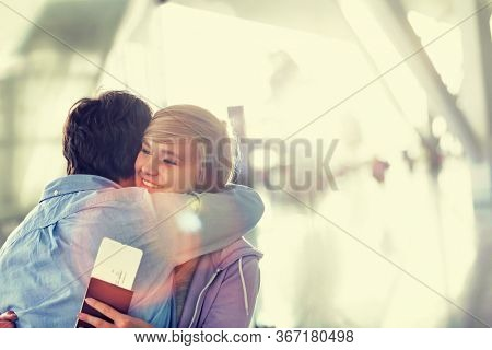 Mature man reuniting with his daughter in airport