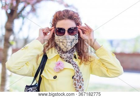 Young Redhead Woman In Mask Holding Sun Galsses At Pandemic Springtime