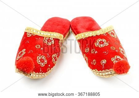 Pair of red embroidered Turkish slippers isolated on white background