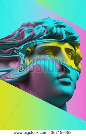 Plaster Sculpture Of Young Man Face In A Pop Art Style. Statue Of Antinous Head. Creative Concept Co