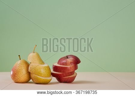 Pear And Apple Divided On Slices. Juicy Mellow Fruits. Summer Harvest. Healthy Lifestyle. Copy Space