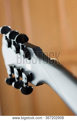 Black Matte Electric Rock Guitar Neck, Wooden Background