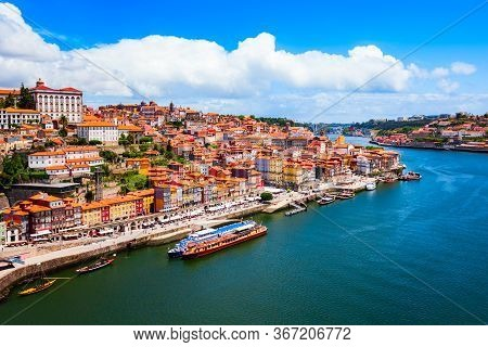 Douro River And Local Houses With Orange Roofs In Porto City Aerial Panoramic View. Porto Is The Sec