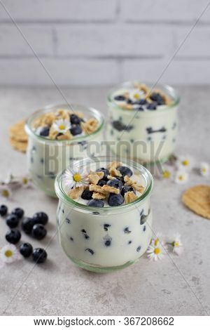 Sweet Puff Dessert In A Glass With Fresh Blueberries, Whipped Cream, Mascarpone, Cottage Cheese And