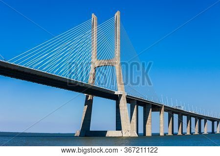 The Vasco Da Gama Bridge Is A Cable Stayed Bridge That Spans The Tagus River In Lisbon City, Portuga