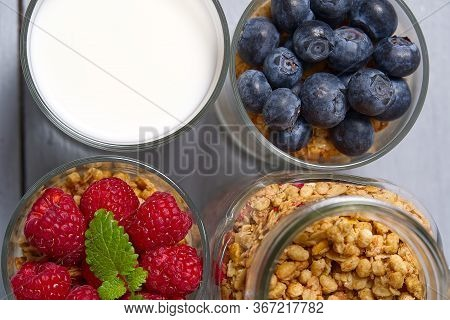 Muesli Dessert With Yogurt And Blueberry In A Glass On Wooden Table Background. Granola In Glass Wit