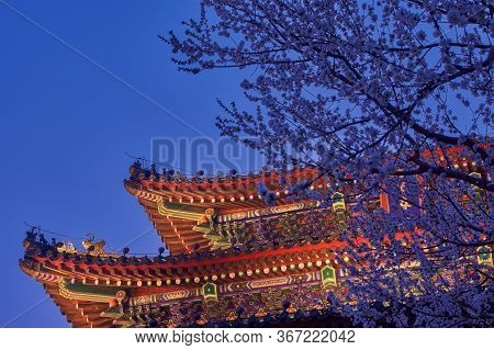 Night View Of Illuminated Pagoda On Top Of The Jingshan Park Hill, Prospect Hill, In Central Beijing