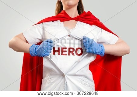 The Doctor, Wearing Gloves And A Superhero Cape, Tears Open The Coat, Showing The Inscription On The