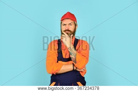 Bearded Worker In Overalls. Confident Mature Mechanic. Portrait Of Repairman. Worker In Storehouse.