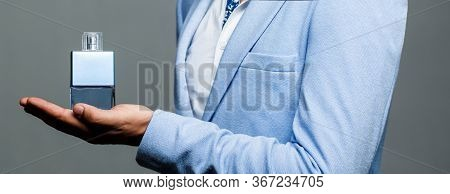 Masculine Perfume. Male Holding Up Bottle Of Perfume. Man Perfume, Fragrance. Perfume Or Cologne Bot