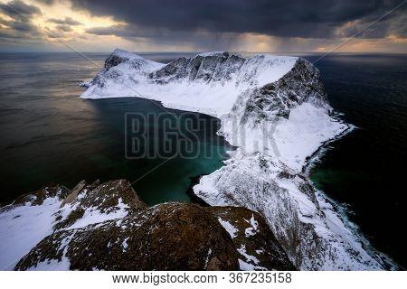Mountain Ridge Of Vaeroy Island At Snowy Winter In Sunset, Lofoten