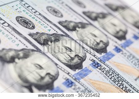 Background Of 100 Dollar Bills. A Pile Of One Hundred Us Dollars - Banknotes. Cash Of Hundred Dollar