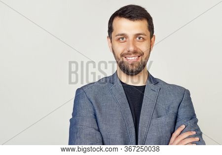 Portrait Of A Young Male Entrepreneur Smiling Broadly With A Self-confident Expression, Businessman