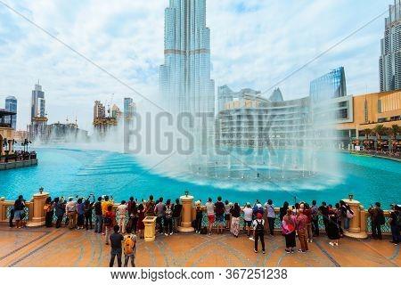 Dubai, Uae - February 25, 2019: Dubai Fountain And Burj Khalifa Tower, A Skyscraper And The Tallest