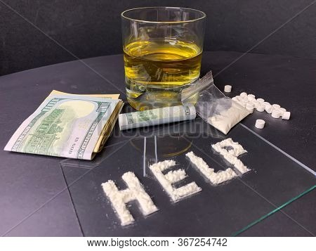 Pills; Us Dollar Banknotes; Whiskey And Cocaine; On A Gray Background. Stop Drugs Concept. A Word